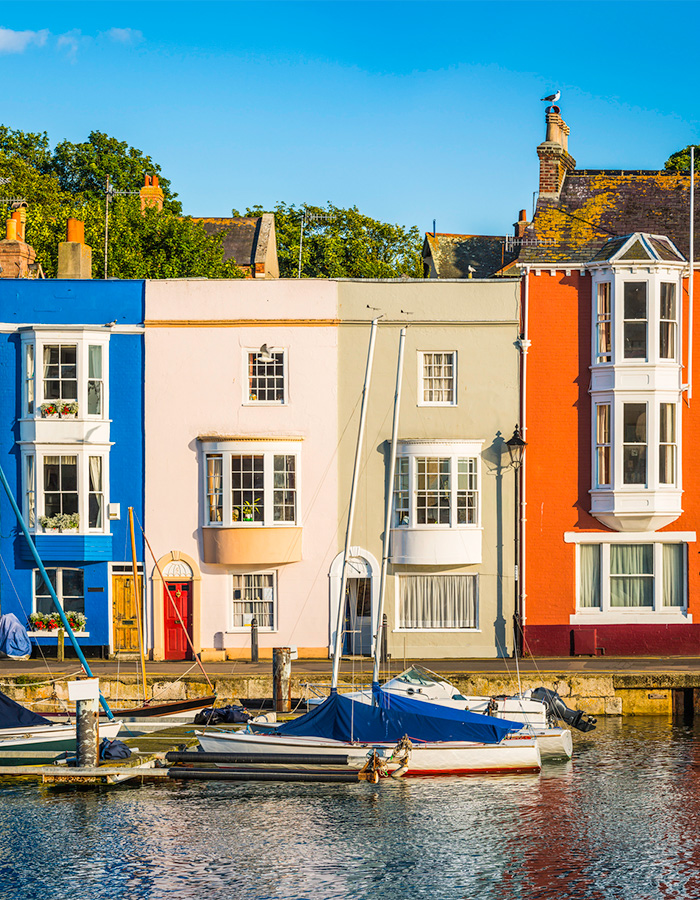 Colorful cottages in a harbor in Dorset