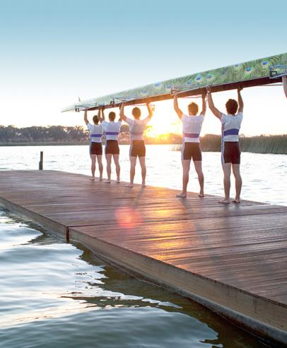A team of rowers lifting a row boat